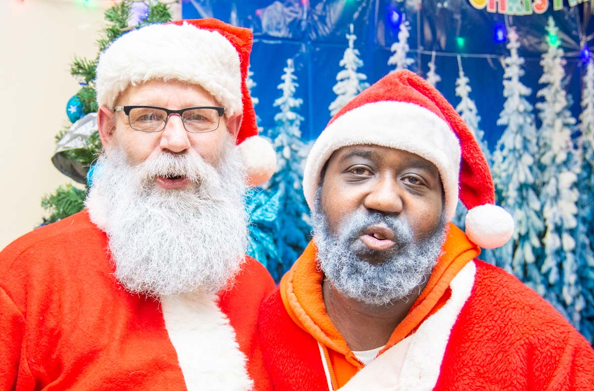 Volunteer Santas at Cornerstone Community Outreach at Christmas time